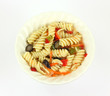 Rotini pasta salad in a small white dish