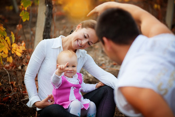 Parents with baby in autumn