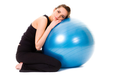 young tired, very attractive female with blue fitness ball, isol
