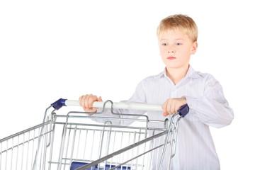 boy near shopping basket. focus on boy's face. isolated.