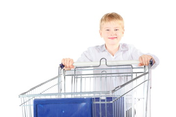 boy near shoping basket. focus on boy's face. isolated.