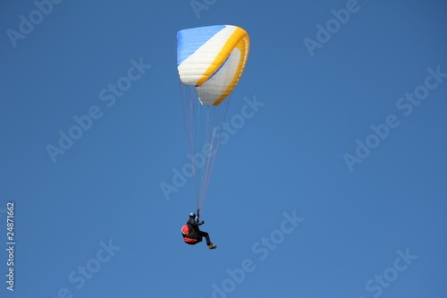 paragliding blue white and orange and sky blue