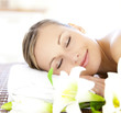 Relaxed woman lying on a massage table
