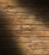 Distressed wooden surface lit diagonally