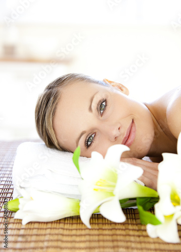 Portrait of a charming woman lying on a massage table smiling at