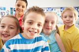 Group Of Primary Schoolchildren In Classroom poster
