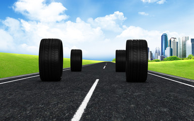 wheels on road with background