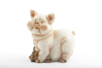 Smiling piggy bank with coins on white