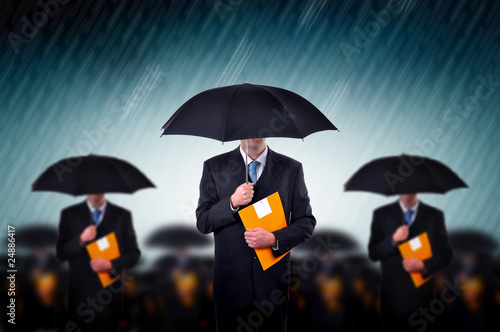 Businessmen in rain