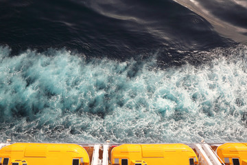 escape boats with yellow roof on cruise ship view from above