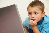 Schoolboy to laptop