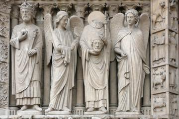 Notre Dame de Paris, Arche sud, Apôtre Denis, décapité