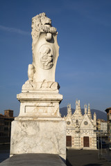 Pisa - lion on the waterfront and gothic chapel