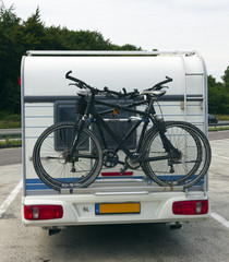 bicycles on the back of a caravan