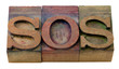 sos sign in letterpress type
