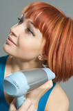 Woman with hairdryer and a hairbrush poster