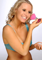 The attractive blond woman in the wonderbra during the making up