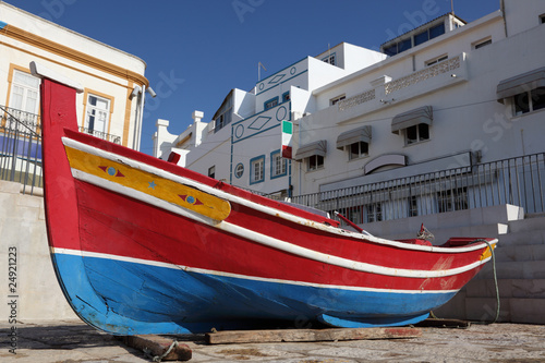 Traditional Portuguese fishing boat in Algarve, Portugal - 24921223