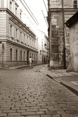 Men is walking in the Czech old city