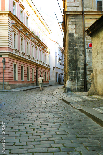 Men is walking in the Czech old city