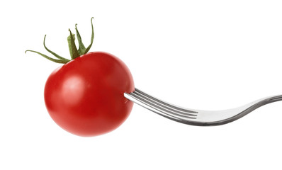 Fresh diet vegetable tomato snack on fork