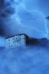 spectral castle shrouded by clouds fog and lightning
