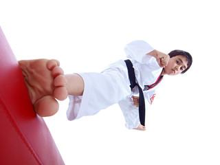child kicking punching bag isolated on white background