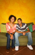 African-American male and female on couch