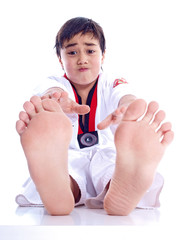 child stretching to reach his toes