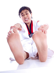 child trying to reach his toes