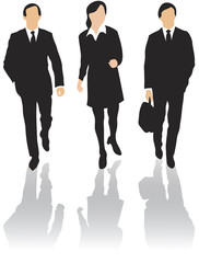 Three business people walking forward