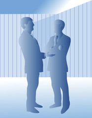 Two business men standing and talking