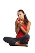 beautiful woman sitting on floor with red apples