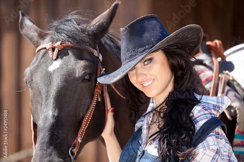 Cute cowgirl on ranch
