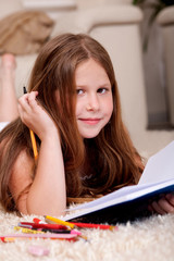 Closeup of cute little girl doing her homework