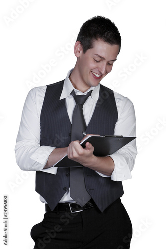 Young man writing on clipboard, studio shot isolated on white