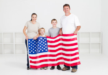 happy american family holding flag
