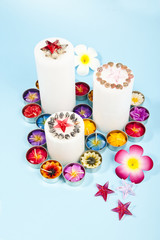 Three candles with red star