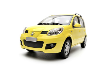 Generic modern yellow family car model on a white background