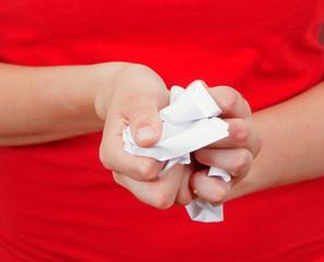 Person crumpling paper