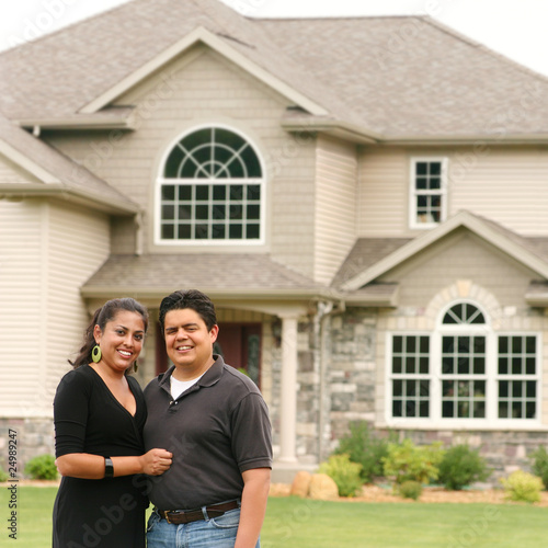 Happy couple in front of a house portrait