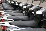 Fototapety scooter mototbikes row many in rent store