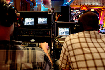 two video operators controlling camera at performance show