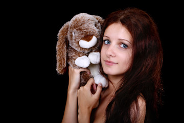 portrait of girl with toy