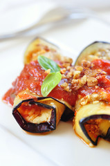 aubergines rolls with feta and tomato sauce