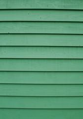 Wooden siding coloured green