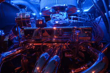Hot rod motor in blue and red neon glow