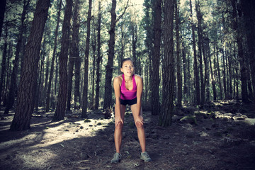 Female runner in forest