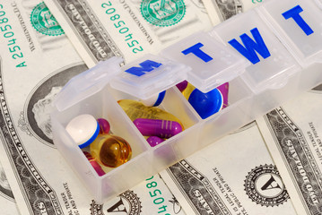Drug holders on dollar bills concepts of rising medical cost