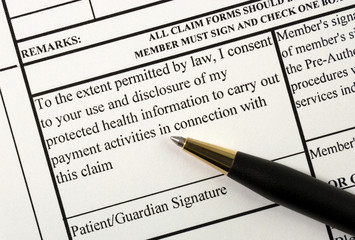 A patient signs the medical claim form